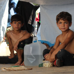Children displaced from ongoing conflict shelter under makeshift tents on Muhalak highway in the western part of Aleppo, Syria. Photo: UNICEF/Khuder Al-Issa