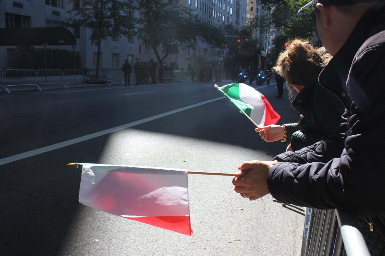 People waving Italian flags. (Photo Rebecca Katz)
