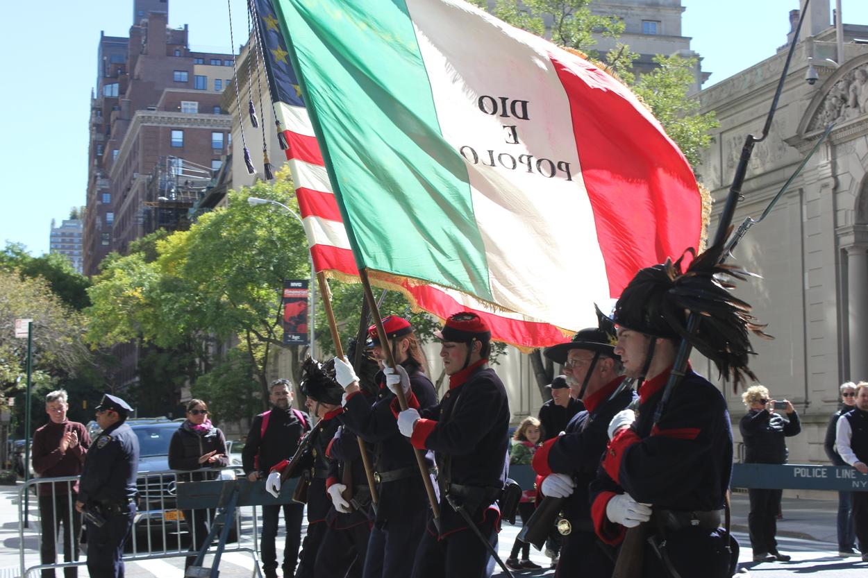 Carabinieri holding the flag with their motto.