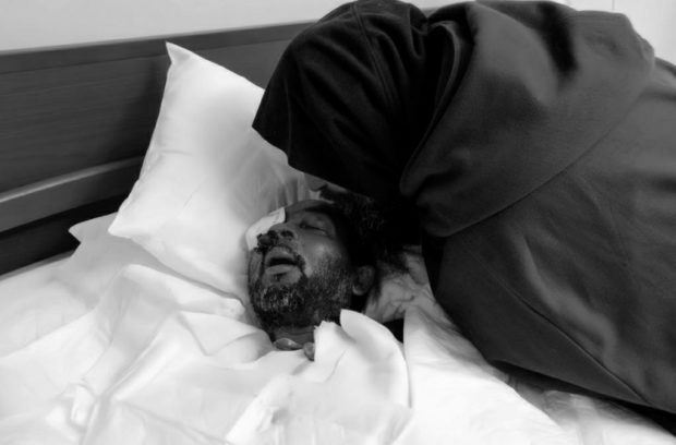 Biagio close to a person hosted in the mission, in the last moments of life at the end of a merciless disease