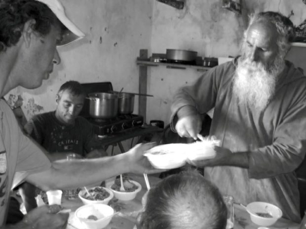 Brother Giovanni, one of the 5 pillars of the mission, distributes food to the poors of the mission