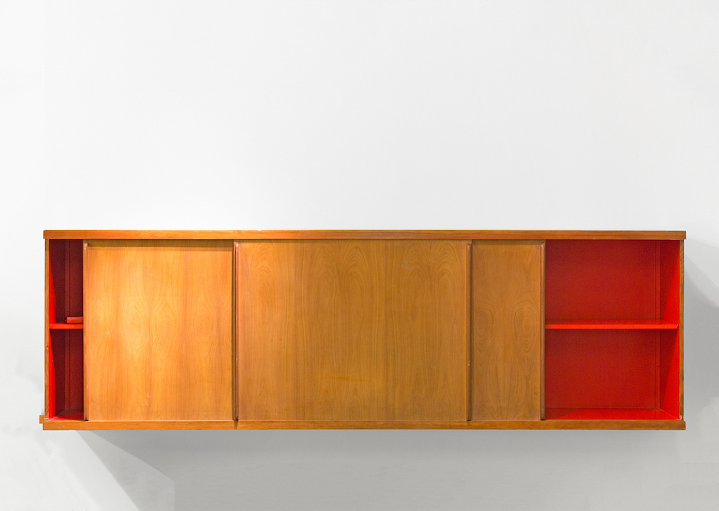 Charlotte Perriand Bahut suspendu, Maison Borot, 1959 wooden structure with black lacquered top, red interior, and three doors 37 1/2 x 120 1/8 x 21 1/4 in 95 x 305 x 53.7 cm unique