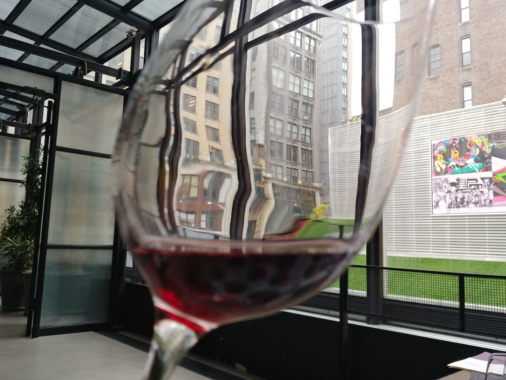 Glass of Ripasso Wine with New York City Building in the Background