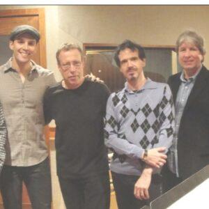Nella foto, Franco Oliveri accanto al titolo, con il gruppo dei suoi collaboratori (da sinistra: Rick Cutler, Ryan Silverman, Yaron Gershovsky, Franco, Mike Hall e Fran Cathcart)
