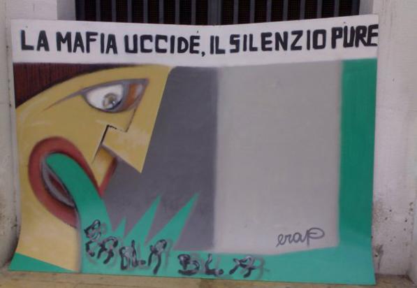 Un poster di una manifestazione antimafia