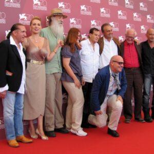 Il regista Gianfranco Rosi e il cast del suo film a Venezia