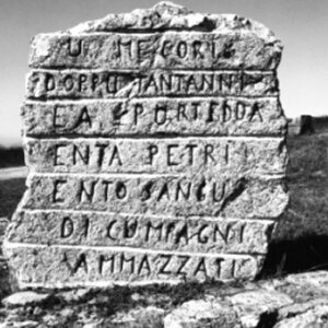 Portella della Ginestra: su una pietra, scolpita una scritta in ricordo dei morti del 1 maggio 1947