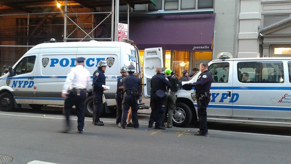 NYPD arresting a legal observer from NLG after the march moved one block from Union Square