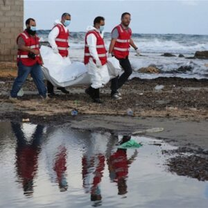 Tripoli Red Crescent teams salvage another body of a migrant, found floating in the sea water in Libya. Photo: Mohamed Ben Khalifa/IRIN